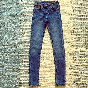 Divided by H&M medium wash skinny jeans
